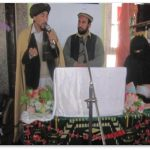 Afghan Mullah preaching into a mic about Women's rights